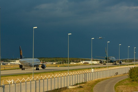 Airplane taxiing in a thunderstorm Editorial