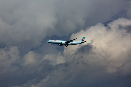 Air Canada on the background of thunderstorm clouds