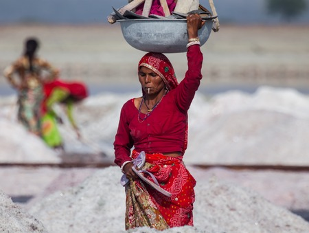 Indian woman with pickaxes