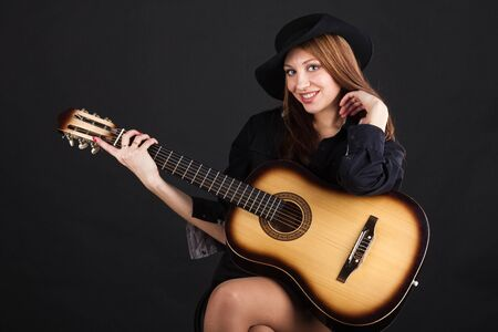 Girl in a hat with a guitar