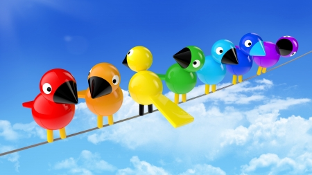 disharmony: rainbow colored birds on a cable in front of blue sky Stock Photo