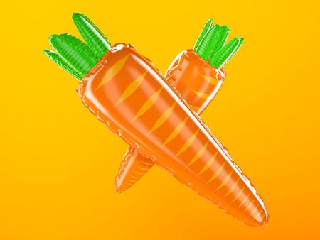 inflatable plastic carrots on orange background