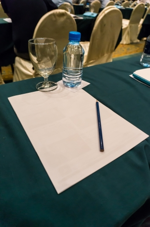 Note paper with pencil in conference room  photo