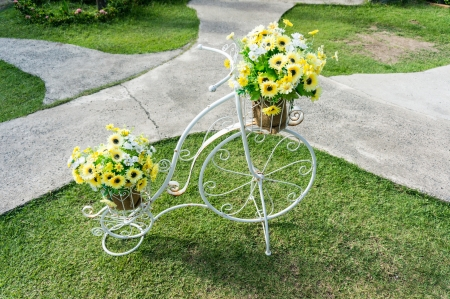 bicycle with artificial colorful flower in Garden photo