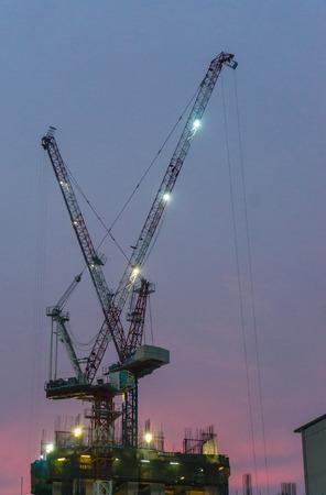 The construction crane on sunset photo
