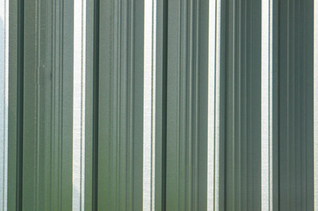 Corrugated metal surface with corrosion seamless texture, metal sheet photo