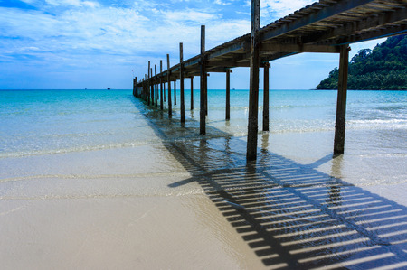 Wooden pier with blue sea and blue sky background photo