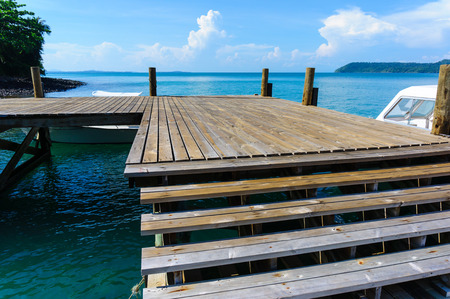 wooden pier on sea with blue sky background photo