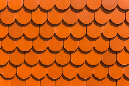 Detail of a house red roof tiles has light of sun shade reflect photo