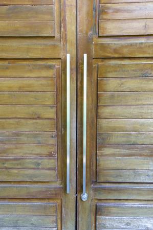 Door handles with an old double door photo