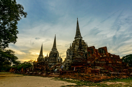 Ancient pagoda at Wat Phra Sri Sanphet temple under blue sky. Ayutthaya, Thailand photo