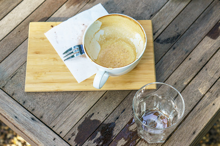 empty of coffee cup after drink on the wood table photo