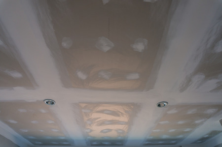parget: plastered ceiling and Downlights of construction in the building, with shadow