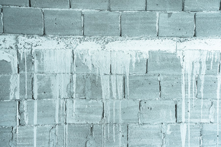 sameness: exterior wall of poured concrete under construction Stock Photo