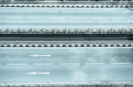 none car on highway. empty of road in city, cold tone