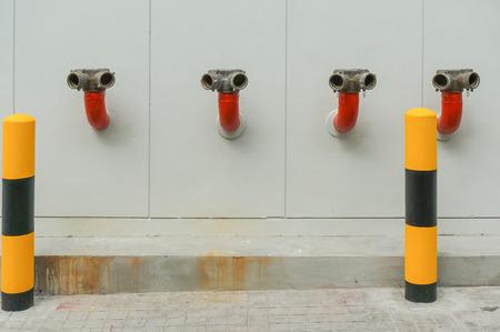 extinguish: water hoses and fire extinguish equipment Stock Photo