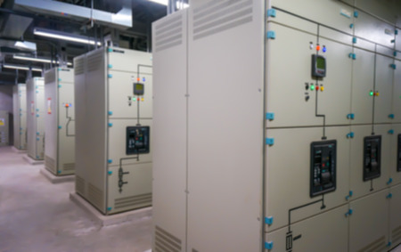 megawatt: Electric amperage control room, in blurred backgroud