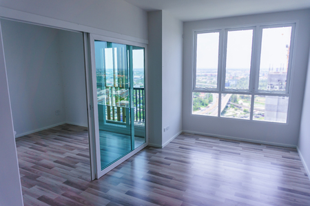 condominium: Living room - Apartment with wooden windows and parquet flooring, Condominium space for rent Stock Photo