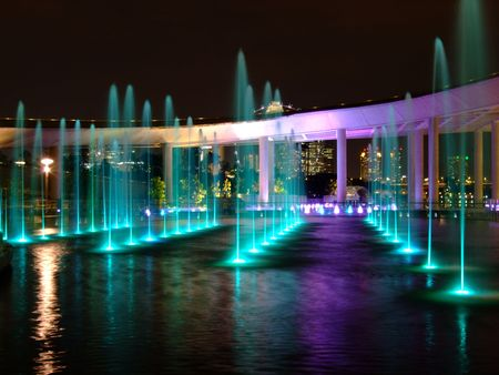 barrage: Water fountain with colourful light reflection at water surface