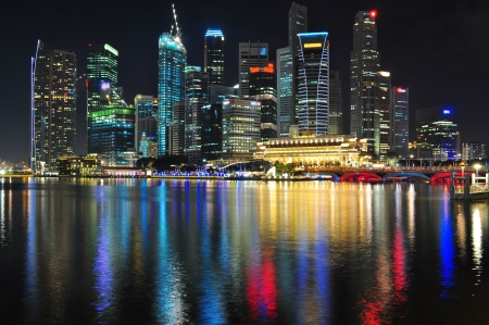 Cityscape by Marina bay with colourful light reflection