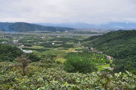 farming area: Scenic Farming area with lots of greenery and mountainous background at Yilan Taiwan. Stock Photo