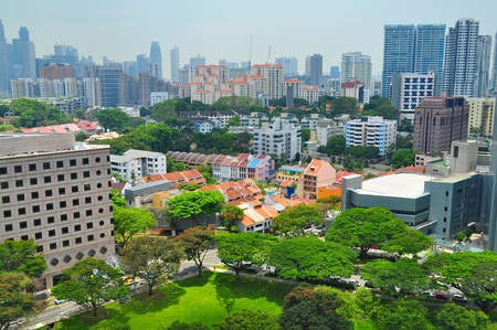 Singapore cityscape at around Orchard CBD area during the day, with a number or low rise and high rise residential buildings, and greenery on the foreground photo