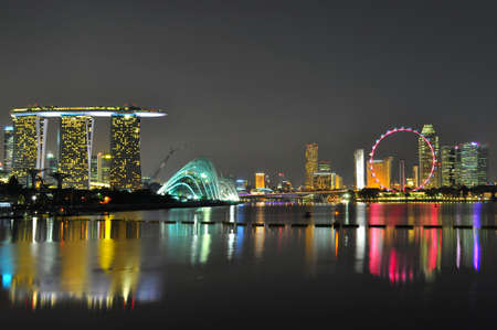 bay city: Wide view of colourful cityscape at Marina Bay, near Marina Barrage