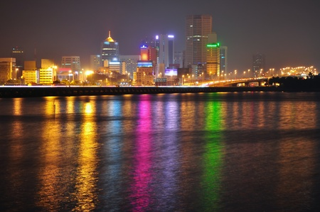 straits: JB (Johor Bahru) cityscape seen from Woodlands, with colourful lights reflection on the water (Johor Straits). Stock Photo