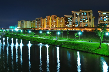 Punggol Waterway with reflection of light on the water, with parks and apartments at the background