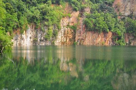 bukit: Hindhede quarry with reflection on the water on a sunny day