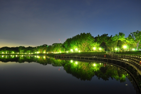 reservoir: Bedok Reservoir by night with lighted trees and their reflection  Stock Photo
