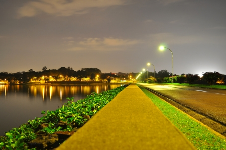 reservoir: A lighted pathway in perspective by Upper Seletar Reservoir  Singapore