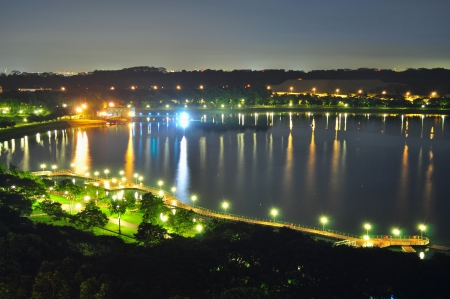 reservoir: Night view of Bedok Reservoir  Singapore  with its lamps and reflections on the water Stock Photo