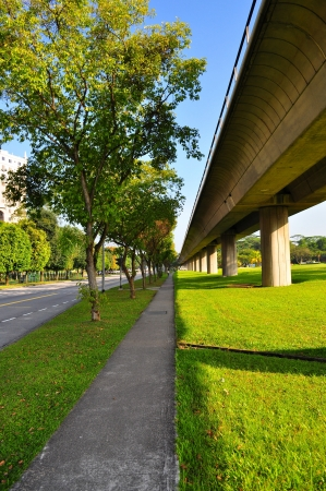 elevated walkway: Perspective view of walkway and elevated train tracks at Yio Chu Kang Stock Photo