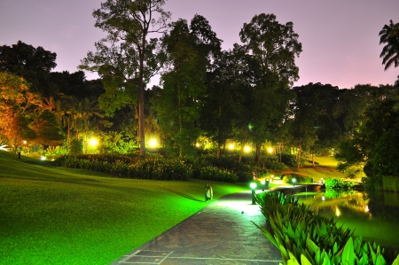 lighted: Walkway at Singapore Botanical Garden by night Stock Photo