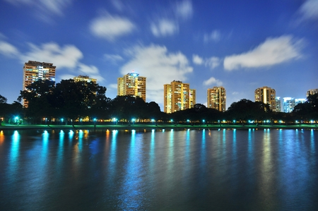 Clouds zooming past a lagoon at East Coast Park, Singapore, by night.
