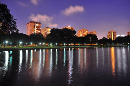 east coast: A Lagoon at East Coast Park, Singapore, with trees, apartments and purple evening sky as background