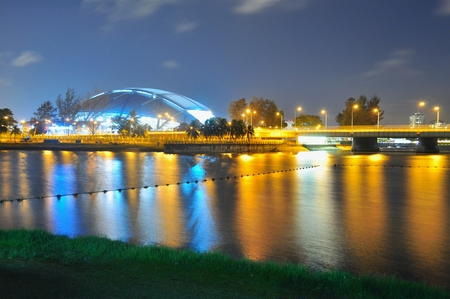 hub: Kallang River by night with Singapore Sport Hub in the background
