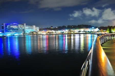 walkway: Harbour front with colourful reflection on the water and boardwalk on the right Stock Photo