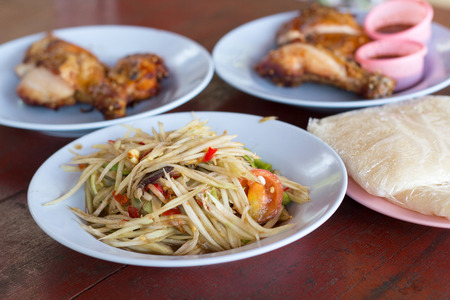 goi: Spicy green papaya salad and roast chicken. Traditional Lao dish known in Thailand as Som Tam