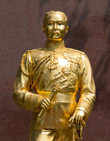 repeal: The statue of King Chulalongkorn with golden color