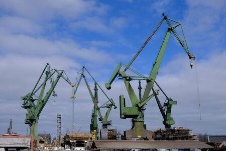 Gdansk, Poland - panorama of Gdanska and green crains in the shipyard