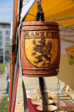 Outdoor event Kashubian Festival. Burczybas with Kashubian coat of arms - black griffin. It is Polish local folk instrument. It is made from a 'bottomless' barrel.