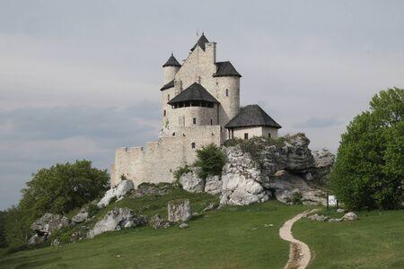 Beautiful fairytale view of Bobolice Castle on rocky hill on Eagles Nests trail. Medieval fortress in the Jura region near Czestochowa. Poland.