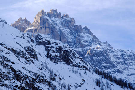 Winter mountain peaks beautifully illuminated by the evening light in valley of Val Fiscalina in Dolomites. Sexten Dolomites, South Tyrol, Italy