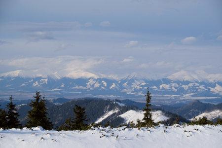 Winter mountain views on red ridge trail from Certovica - Sedlo za Lenivou - Sedlo Homolka during snowshoe tours in Low Tatras in Slovakia Reklamní fotografie