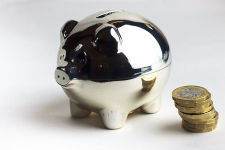 Piggy bank and coins Banco de Imagens