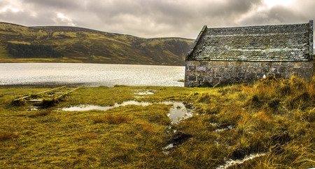 Scotland landscape. A boathouse at the edge of Loch Muick. Royal Deeside. Cairngorms National Park, Aberdeenshire, Scotland, UK.