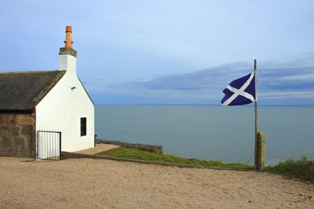 White house and scottish flag. St Cyrus beach, Angus, Aberdeenshire, Scotland, UK