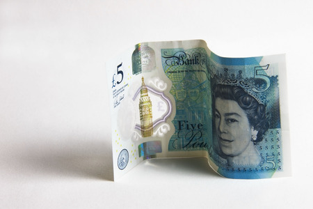 Five pound sterling plastic bank note